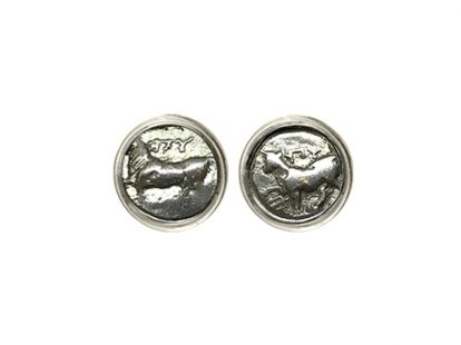 Silver cufflinks with coins depicting a figure of Cow